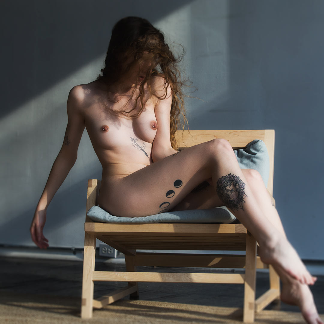 Woman nude in chair